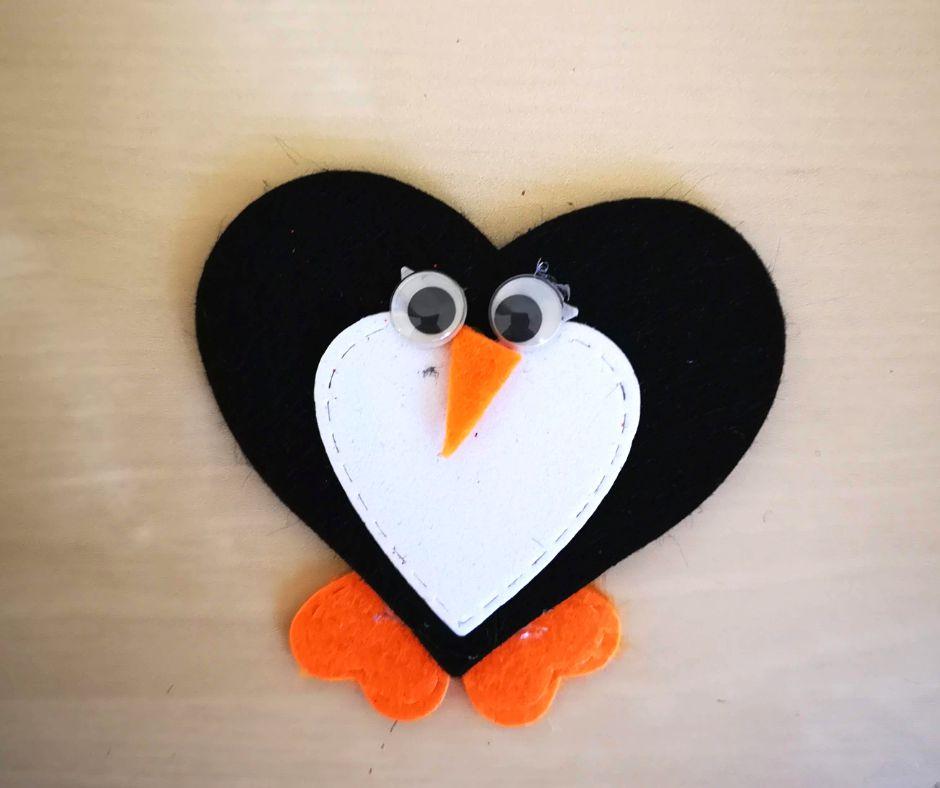 pinguino a forma di cuore